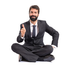 Businessman with thumb up over white background