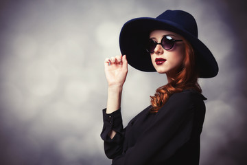 Style redhead women with sunglasses.