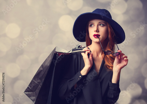 canvas print picture Style redhead girl with shopping bags.