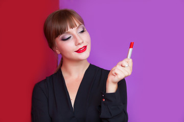 Brunette girl holding lipstick