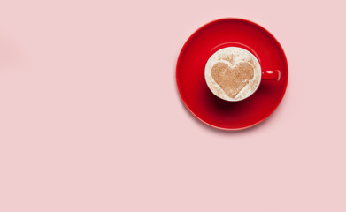 Cup of coffee with heart shape symbol on color background.