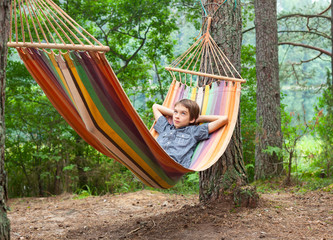Child in hammock outdoors
