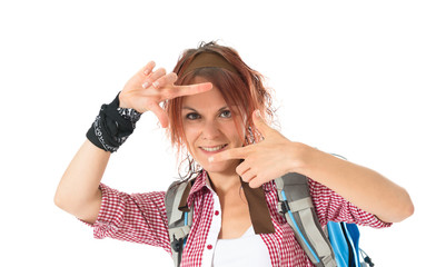 backpacker focusing with her fingers on a white background