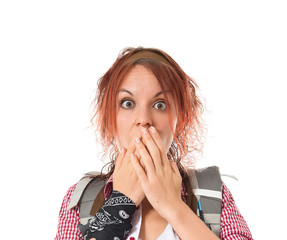 backpacker doing surprise gesture over white background