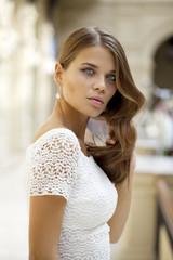 Young beautiful woman in white dress