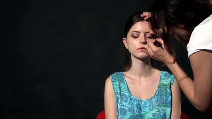 Applying make up in a studio