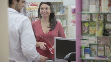 Happy woman at pharmacy