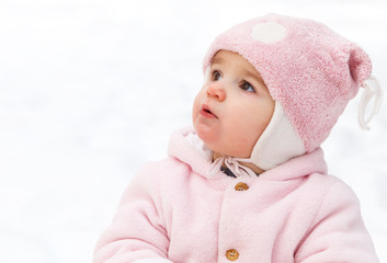 Happy funny baby in winter park