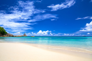 Tropical sand beach and blue sky, Mahe Island, Seychelles