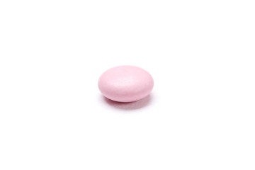 Pink tablet, isolated on white. Healthcare concept