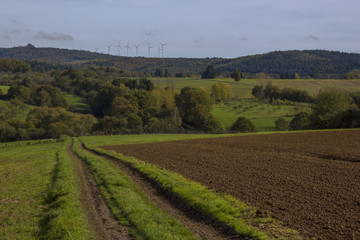 farmland with wind turbines