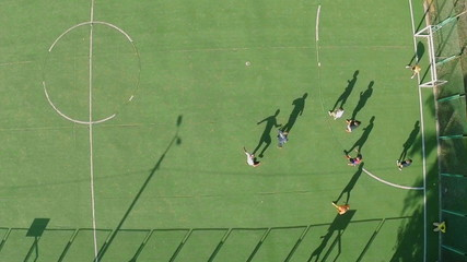 Amateur football, aerial shot of players running on the field