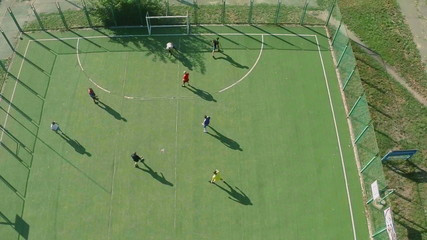 Aerial view of school college team playing football, active rest