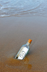 Glass bottle with digital message, @