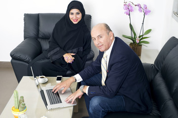 Senior Businessman & woman wearing Hijab meeting in office