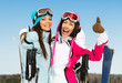 Half-length portrait of two female downhill skier friends