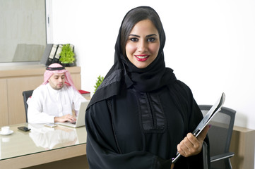 Arabian Businesswoman with her boss on Background