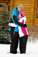 Full-length portrait of embracing couple during winter holidays
