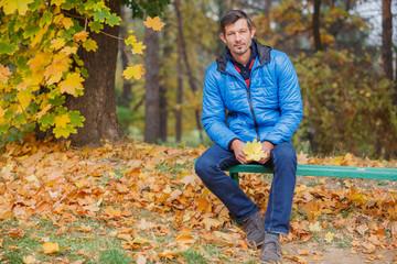 Man in the autumn park