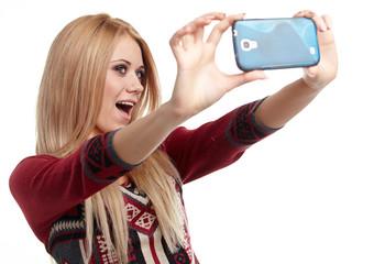 a beautiful blonde  girl taking selfie