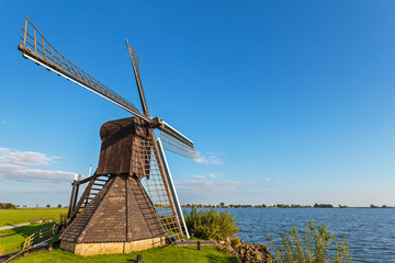 Old wooden windmill in the Dutch province of Friesland