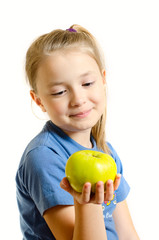the young girl admires apple
