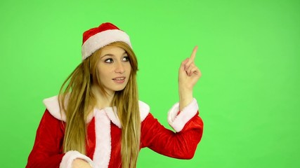 Christmas - Holidays - green screen - woman shows at time