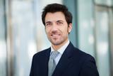 Handsome smiling businessman portrait
