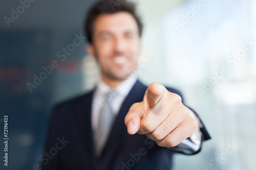 Businessman pointing his finger at you - 72196433