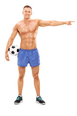 Shirtless football player pointing with hand
