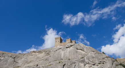 The tower of the ancient castle on a rock