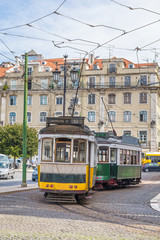 View of two old trams in touristic downtown lisbon, Portugal, Eu