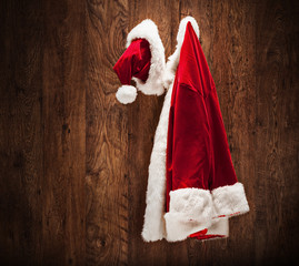 Santa costume hanging on a wooden wall