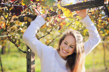 Beautiful smiling girl in a vineyard
