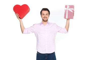 Man holding presents wrapped in gift paper, isolated on white.
