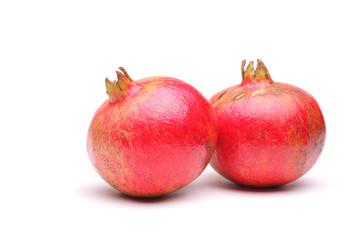 Studio shot of two pomegranates