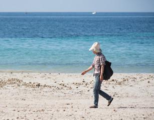 masseuse walking on the beach