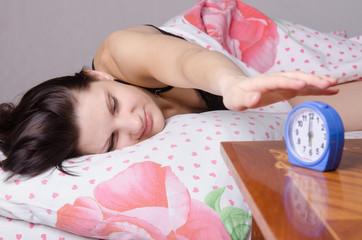 Girl having fun off the alarm rings