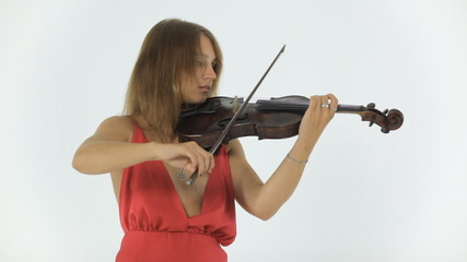 Girl violinist emotionally plays on her musical instrument
