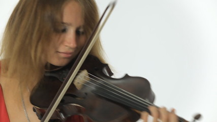 Talented girl violinist playing on her a musical instrument