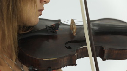 Young talented girl masterfully plays the violin