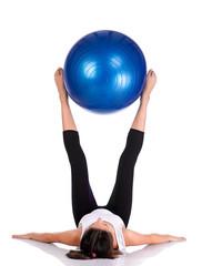 Fitness girl working on exercising ball