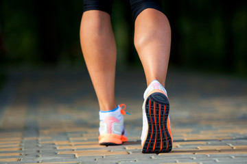 a woman with an athletic pair of legs going  a jog