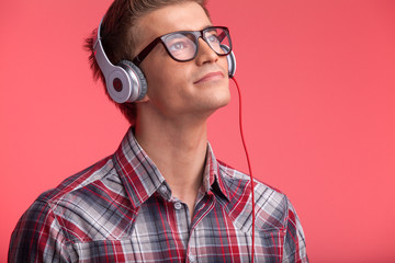 portrait of young man with glasses and headphones.