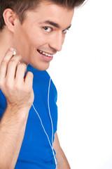 closeup on smiley guy in earphones listening music