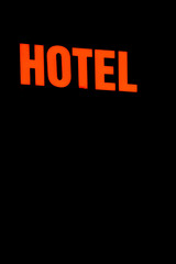 Neon Sign with the word Hotel.