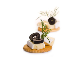 Canape with Brie Cheese and Olives isolated on white