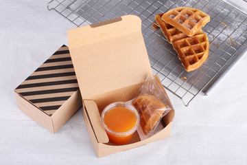 stacked homemade waffles on sieve