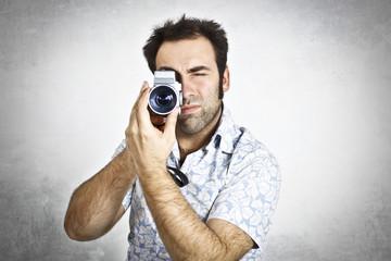 Man using a video camera