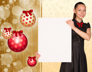 Businesswoman holding empty paper. Christmas tree balls